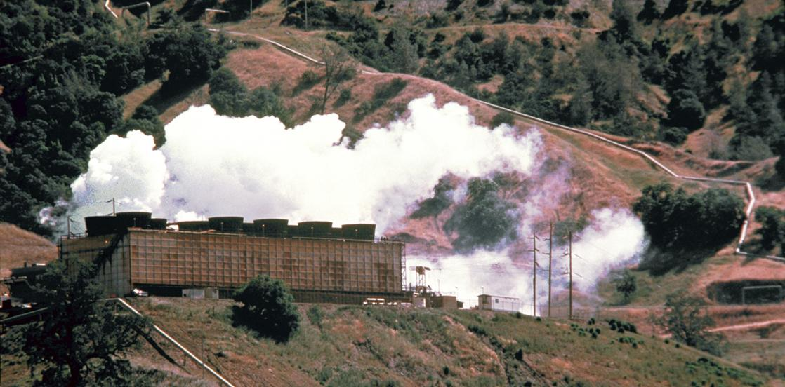 A photograph shows an energy plant on a hillside with clouds of white steam immediately above the plant