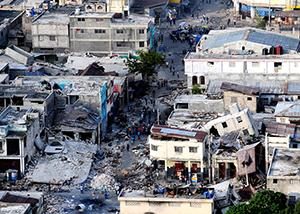 A town with collapsed buildings after an earthquake.
