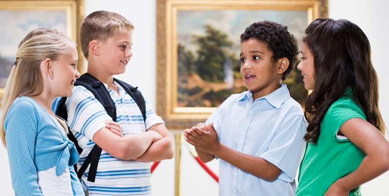 Image of a group of students having a discussion in an art gallery