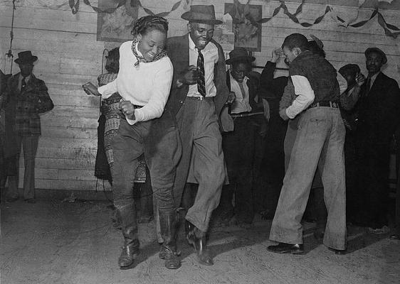 Two dancers jitterbugging at a juke joint, November 1939 via wikimedia