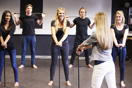 Image of students learning a routine from an instructor