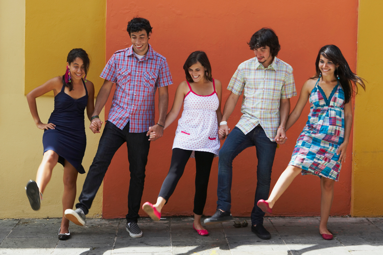 Image of five young people moving in sync