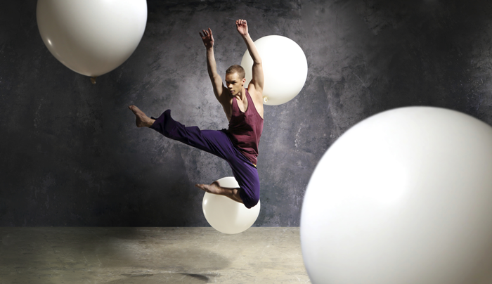 Image of dancer performing on stage with props