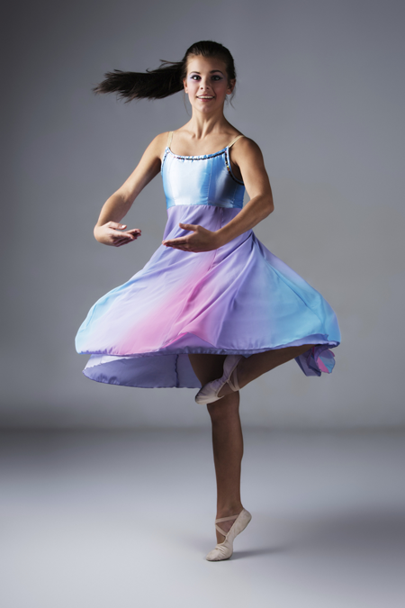 Image of dancer spinning in colorful dress