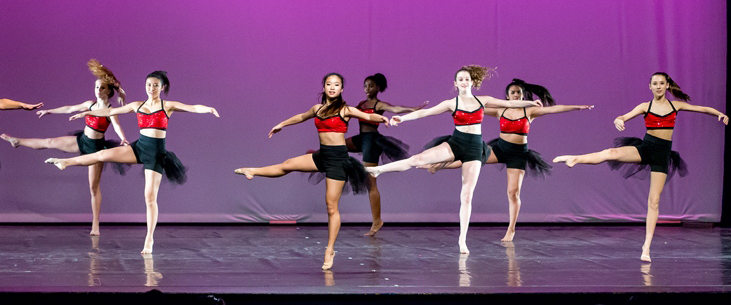 Image of dancers in motion on stage