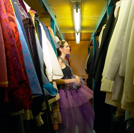 Image of dancer in costume storage room