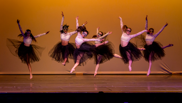 Image of dancers in costume performing on stage