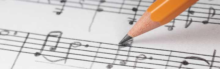 Image of writing notes on sheet music with a pencil