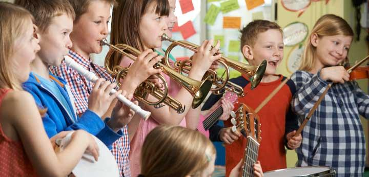 Image of children playing instruments in a classroom