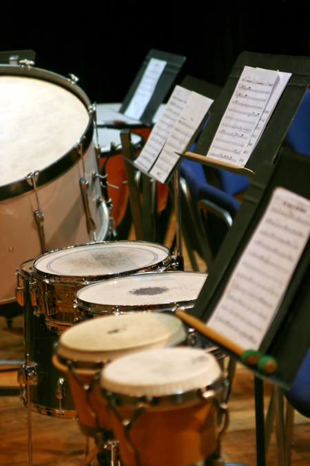 Image of percussion instruments with sheet music on stands