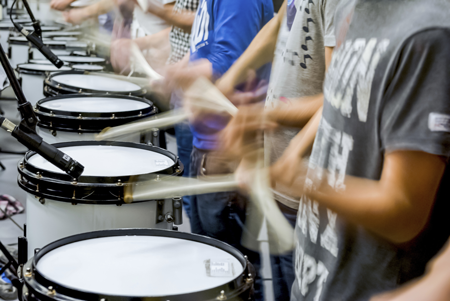 Image of a drumline in motion