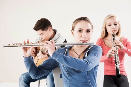 Image of band students playing instruments in a classroom
