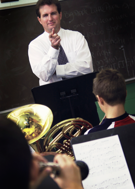 Image of a band director in front of students