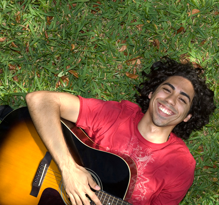 Image of a young man with guitar