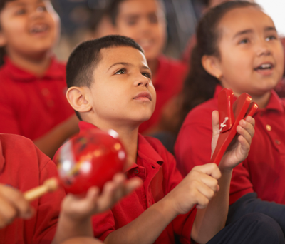 Image of young children with percussion instruments