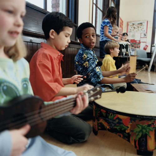 Image of students playing instruments in class