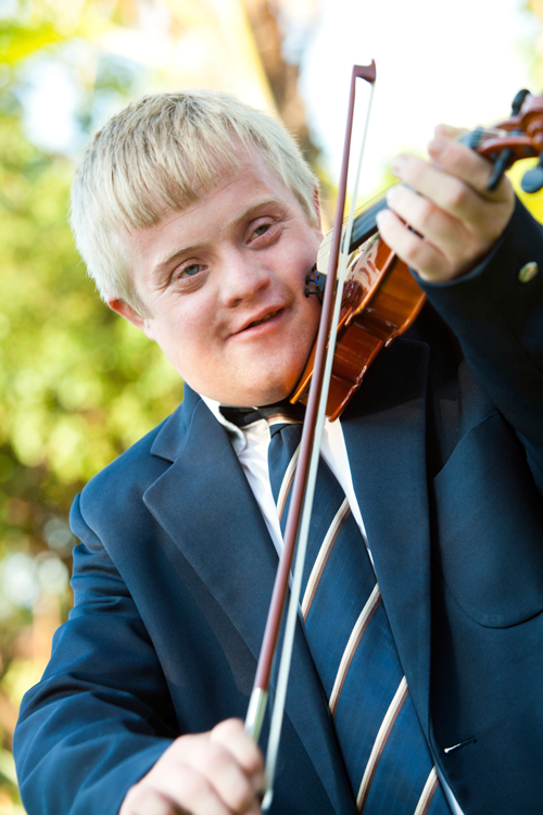 Image of special needs student playing violin