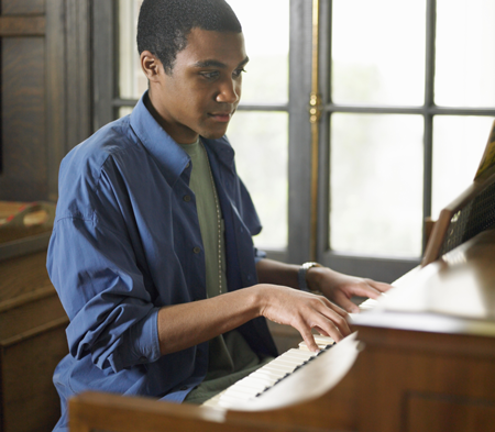 Image of student playing piano
