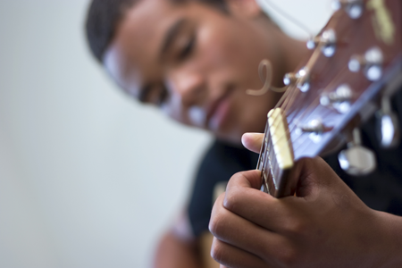 Image of boy playing the guitar