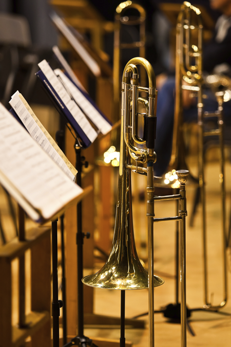 Image of trombones and sheet music on stands