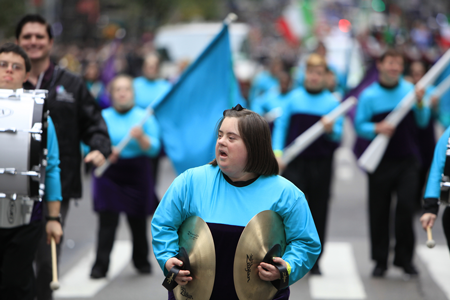 Image of a student with cymbals in a marching band