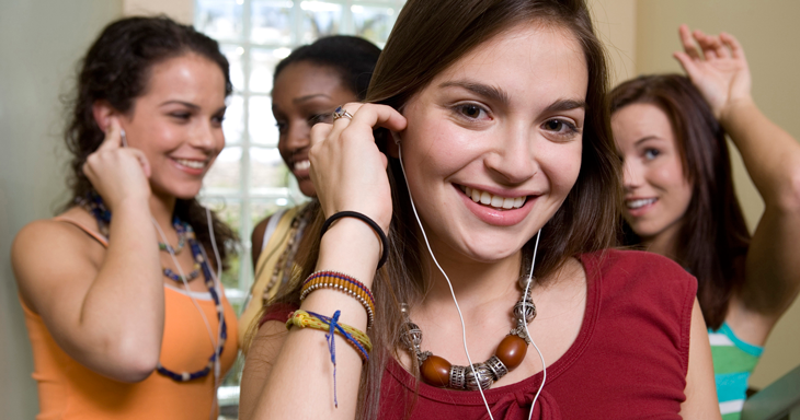 Image of a group of girls with headphones