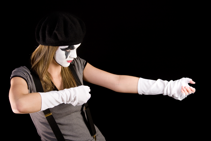 Student mime pulling invisible rope
