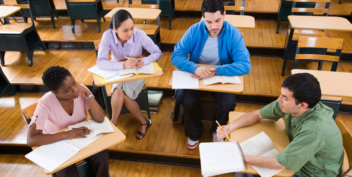 Students studying in group at desks