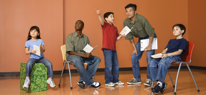 Image of students and teacher rehearsing
