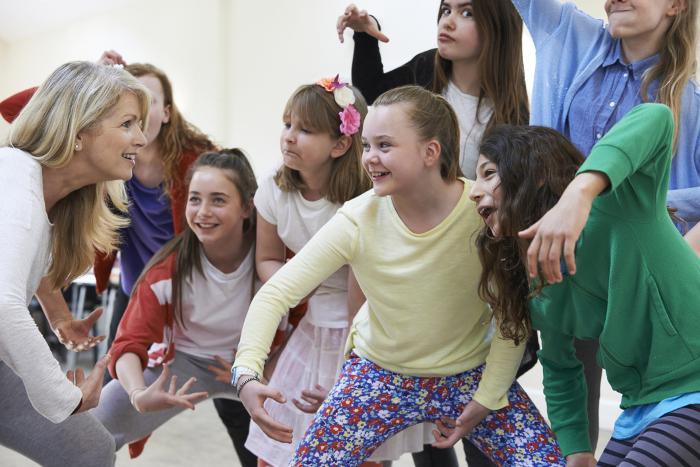 Teacher and children practicing