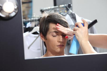 Teen getting makeup for performance