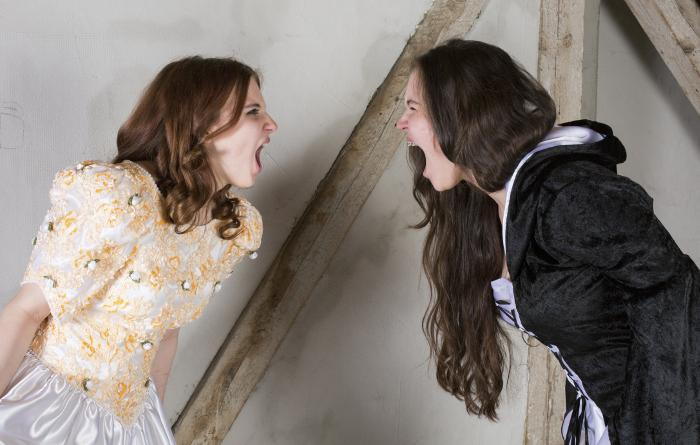 Two girls in costume screaming at each other