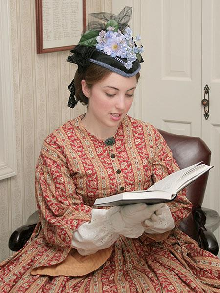 Student in costume reading monologue