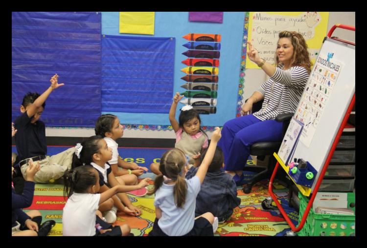 teacher leading a class of young children