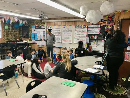 A TXLS teacher teaches the Research Lesson while being videotapes
