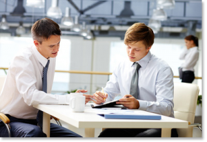 A WBL student working with his supervisor in an office