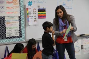 female teacher explaining something to a student