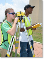 Two male students on a survey crew